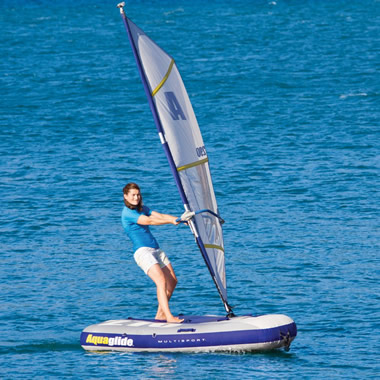 The Inflatable Windsurfer And Sailboat.