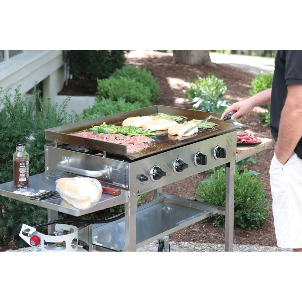 The backyard flat top grill hammacher schlemmer for Gas grill tops outdoor kitchen