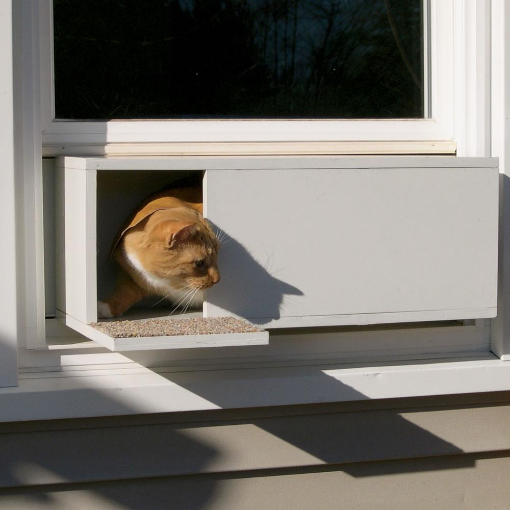 The Easy Mount Window Cat Door Hammacher Schlemmer