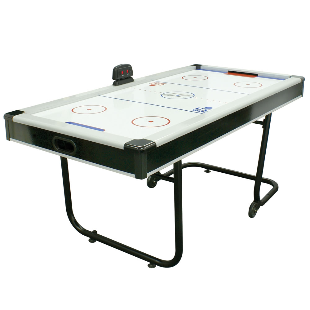 The space saving air hockey table hammacher schlemmer for Table hockey