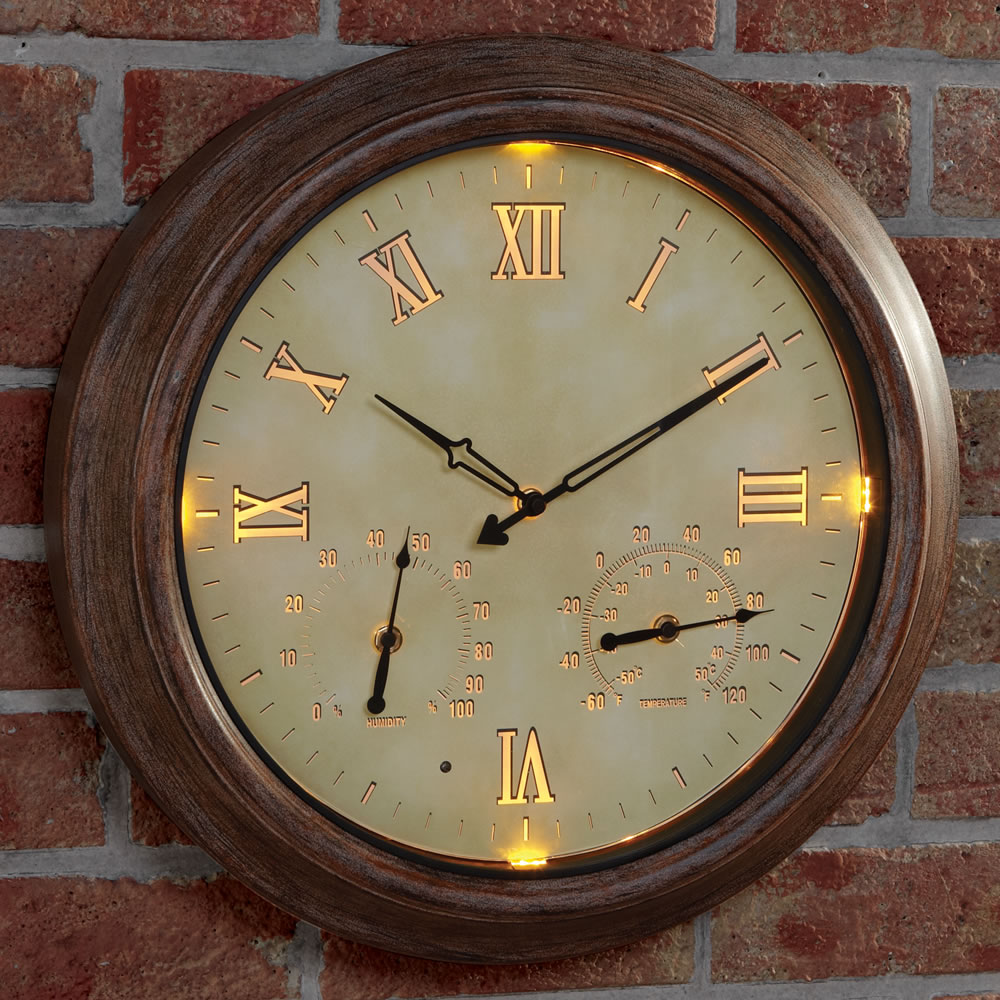 The only cordless illuminated outdoor clock hammacher schlemmer - Digital illuminated wall clocks ...