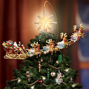 The Thomas Kinkade Revolving Christmas Tree Topper.