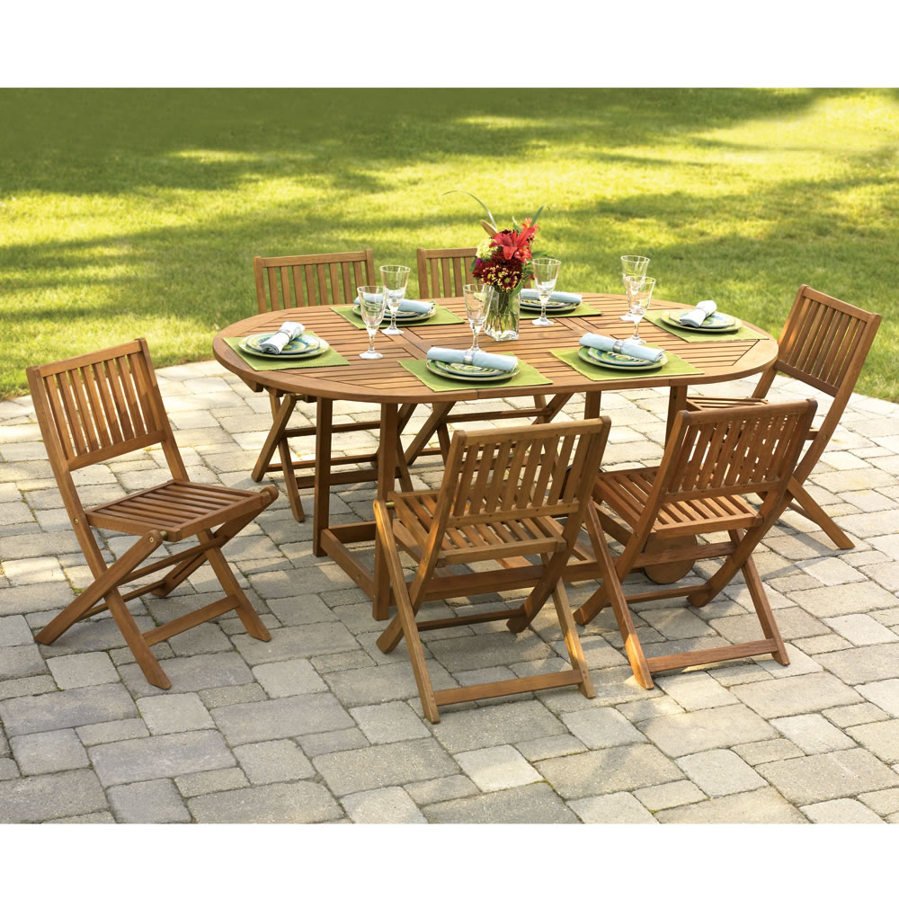 The gateleg patio table and stowable chairs hammacher for Deck table and chairs