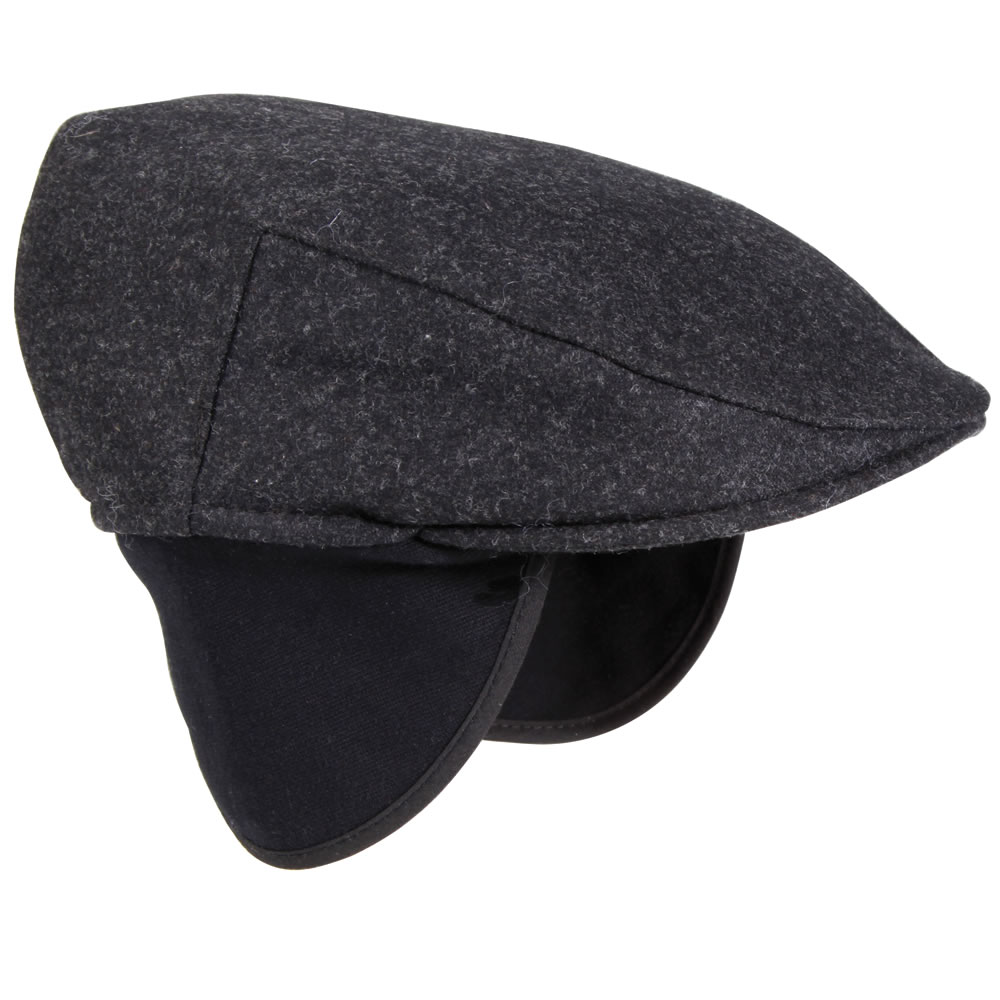 The Galaxy is a Kangol interpretation of a classic 8-quarter cap. Knitted and blocked with ridges that imply each section of the crown, and a button in the center.