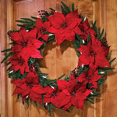 The Cordless Prelit Poinsettia Wreath.