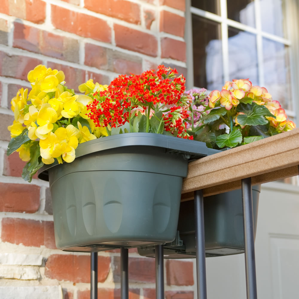 the adjustable balcony rail planter hammacher schlemmer