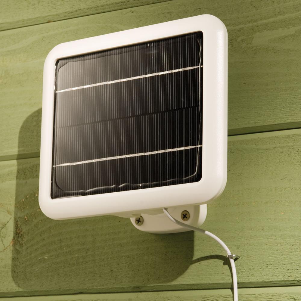 the solar powered video security light hammacher schlemmer. Black Bedroom Furniture Sets. Home Design Ideas