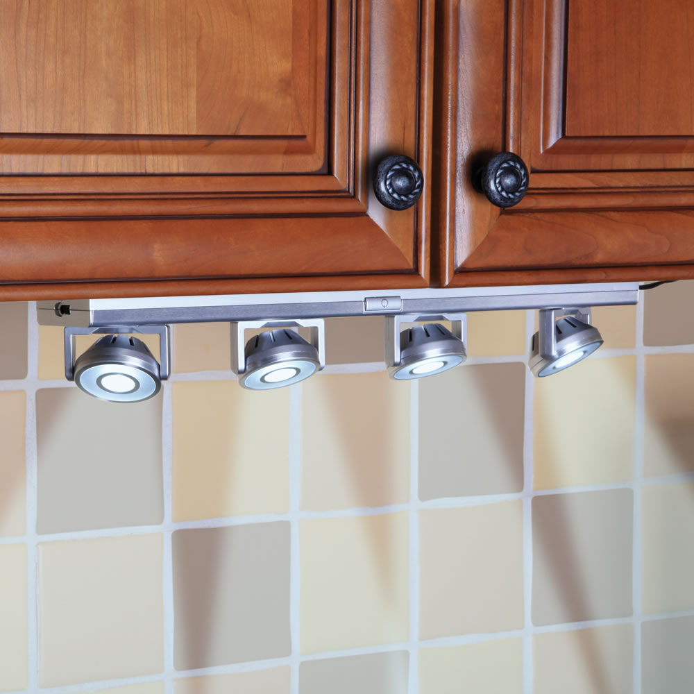 the under cabinet pivoting spotlights hammacher schlemmer
