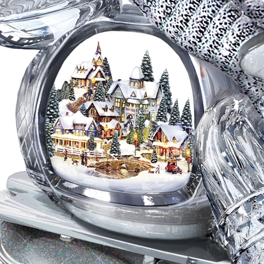 The Thomas Kinkade Illuminated Musical Sledding Snowman 2