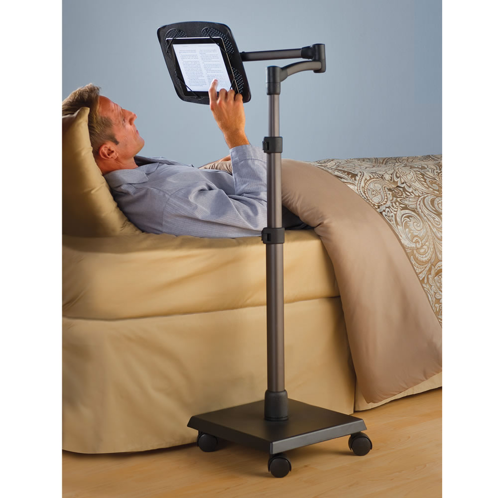 the rolling bedside ipad stand hammacher schlemmer you need this ipad holder for bed tstand
