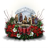 The Thomas Kinkade Crystal Nativity Floral Piece.