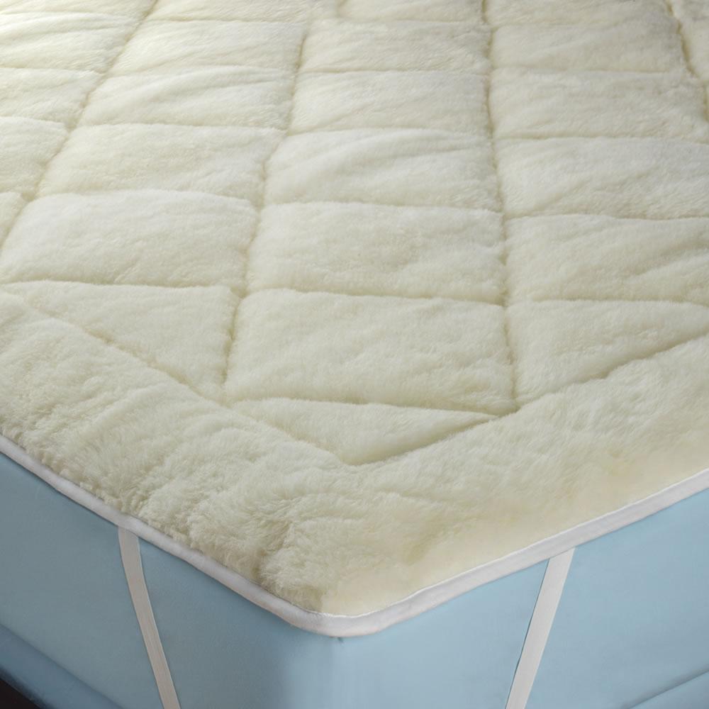 The All Season Reversible Cotton Wool Mattress Pad