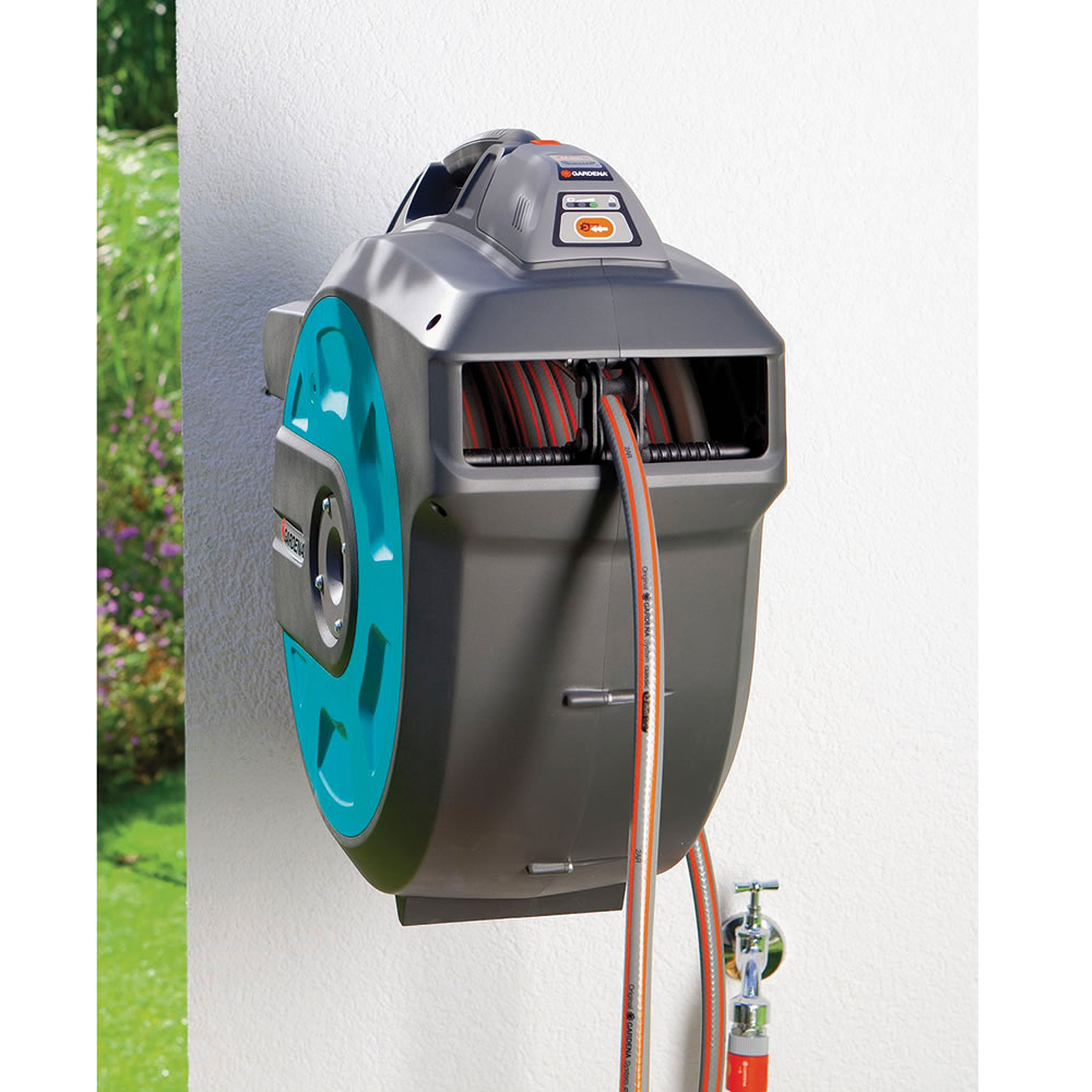 The Automatic Retracting Hose Reel - Hammacher Schlemmer