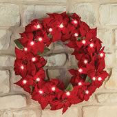 "The 24"" Cordless Prelit Poinsettia Wreath."