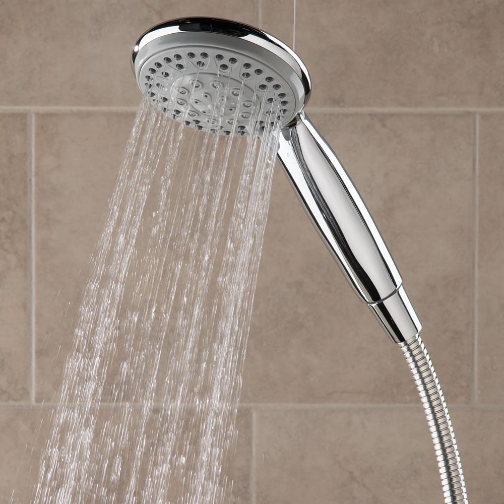 the superior pressure boosting handheld showerhead hammacher schlemmer