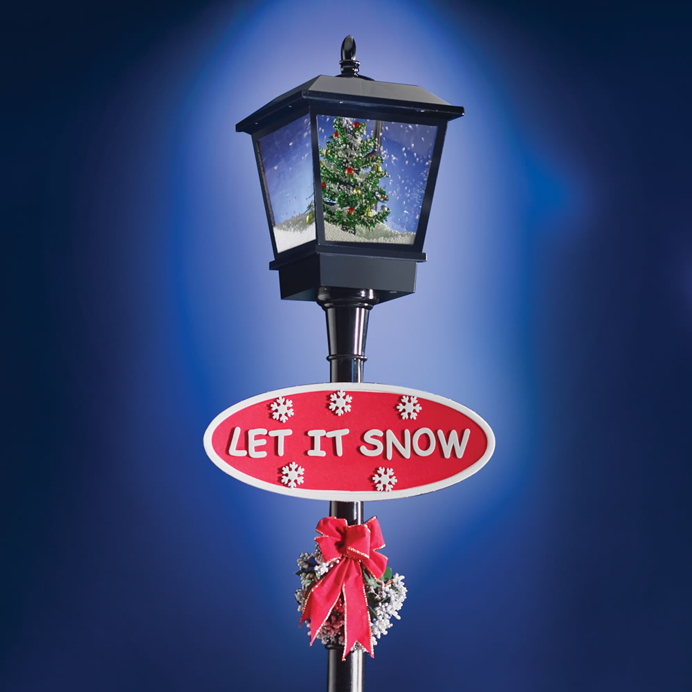 Snowing christmas decoration let it snow - The Christmas Caroling Lamppost
