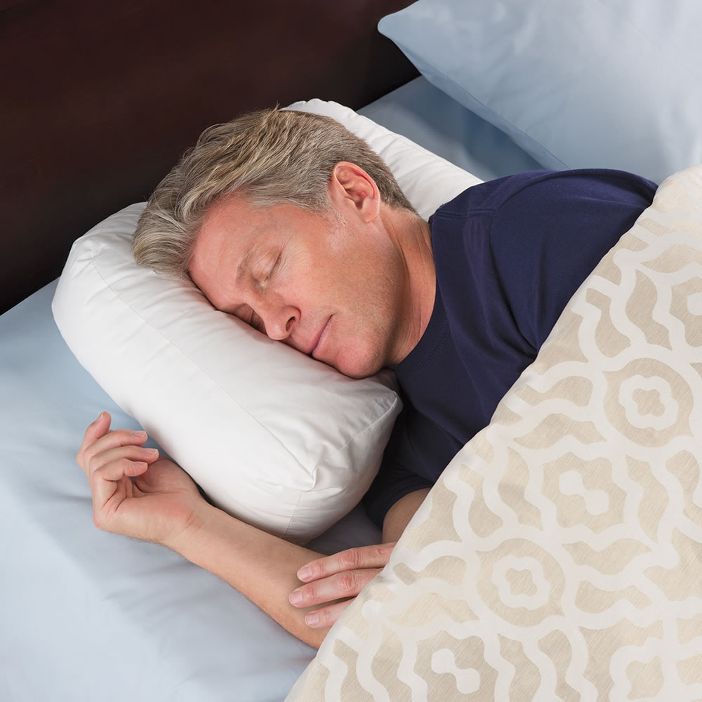 The Side Sleeper S Ergonomic Pillow Hammacher Schlemmer