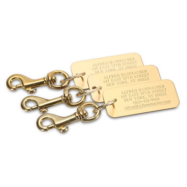 The Personalized Brass Luggage Tags.