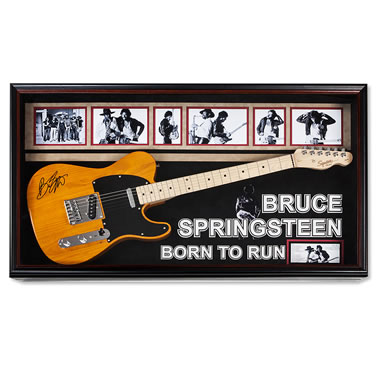 The Bruce Springsteen Born To Run Autographed Guitar - Displayed on wall