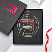 """This is the personalized book that recaps the cinematic journeys of the comic book heroes featured in Marvel Studio's formative years. From Tony Stark's armored suit creation while being held captive in an Afghan cave, to the story of Steve Rogers, a wannabe WWII recruit turned into genetically enhanced super-soldier """"Captain America"""", this book brings together the mightiest heroes from the Earth and beyond. With its soft touch laminated finish and over 100 pages of content, this coffee table sized book is the perfect page-turning gift for fans of the Marvel Universe. Gold embossed with the recipient's name (up to 12 characters) on the cover and a personalized message up to 80 characters (40 on each line) on th"""