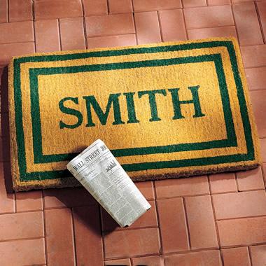 The Dirt-Capturing Oversized Name Doormat.