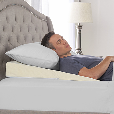 The Sleep Improving Pillow Wedge - Shown on bed