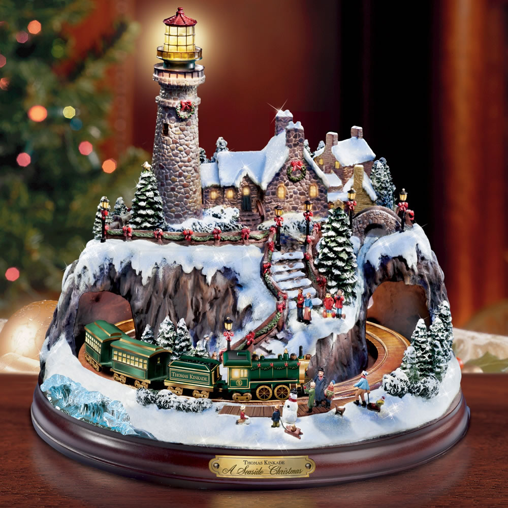 The Thomas Kinkade Christmas Seaside Village Hammacher