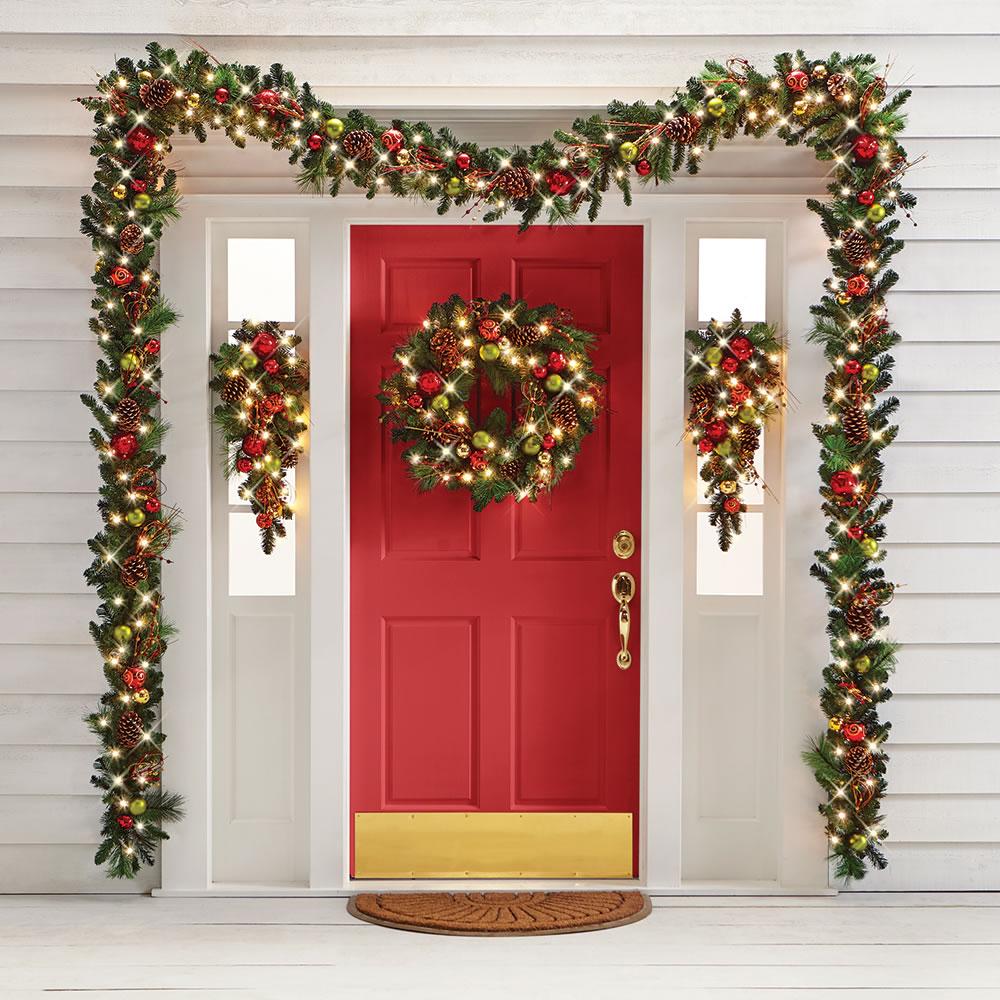 The Cordless Prelit Ornament Trim Wreath Shown In Doorway