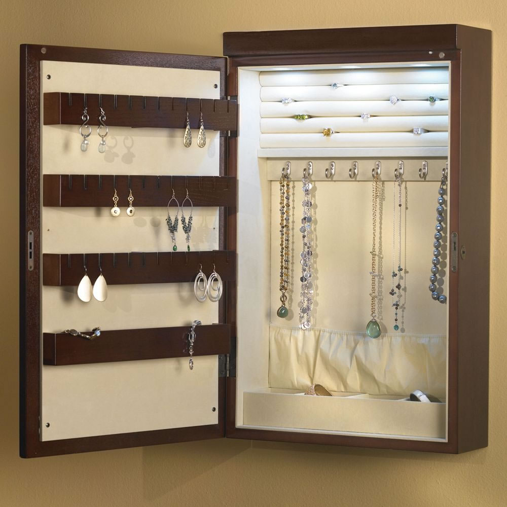 The 24 Wall Mounted Illuminated Jewelry Armoire Hammacher Schlemmer