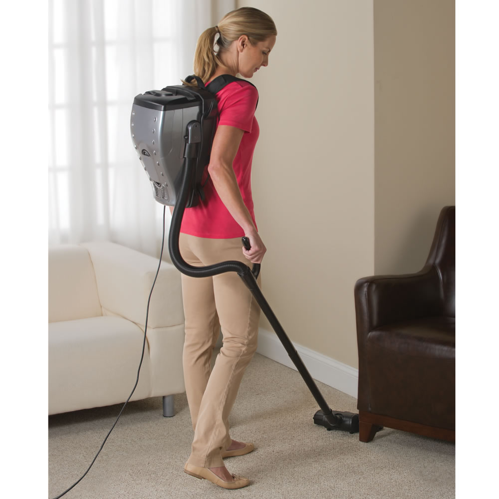 the backpack vacuum hammacher schlemmer. Black Bedroom Furniture Sets. Home Design Ideas