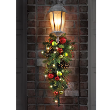 The Cordless Prelit Ornament Teardrop Sconce - Shown in doorway