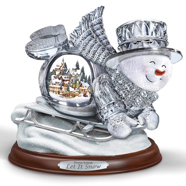 The Thomas Kinkade Illuminated Musical Sledding Snowman