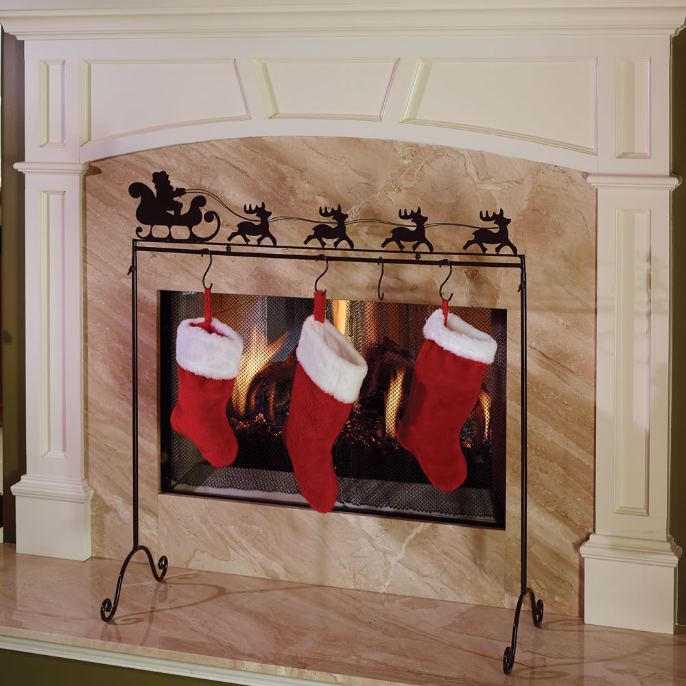 This is the sturdy decorative wrought iron frame that safely displays Christmas stockings in front of a fireplace.