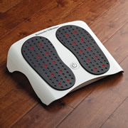 """Developed for Hammacher Schlemmer using technology pioneered by NASA to heal astronauts' injuries, this device's 172 LEDs produce safe infrared heat to stimulate blood circulation, relieve swelling, and loosen muscles in the feet. It is the only of its kind made specifically for the feet. A study at Children's Hospital of Wisconsin in Milwaukee showed the LED technology reduced painful inflammation by up to 37%. Unlike heating pads that only treat just below the skin's surface, the light from the unit's 152 infrared LEDs (invisible to the naked eye) and 20 red LEDs penetrates deep into tissue to help relieve the soreness common with plantar fasciitis, neuroma, and tendonitis. Automatically turns off after 20 minutes. The infrared light provides penetrating warmth so safe and comforting, hospitals use it to warm newborns. Plugs into AC with a 6' cord. 16"""" L x 13"""" W x 4 1/2"""" H. (5 lbs.)"""