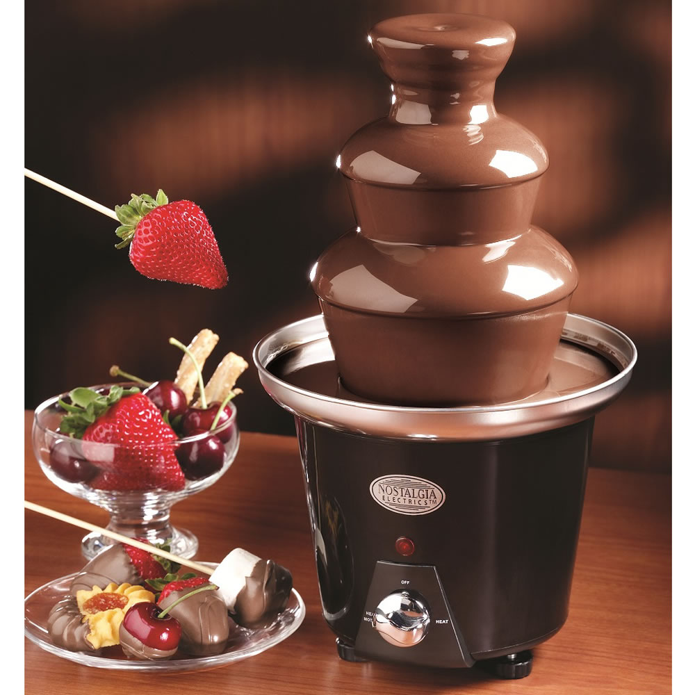 the chocolate fondue fountain hammacher schlemmer. Black Bedroom Furniture Sets. Home Design Ideas