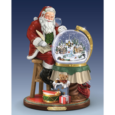 The Thomas Kinkade Santa Snowglobe