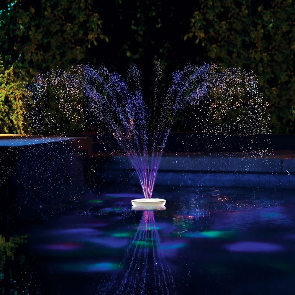 The floating lighted pool fountain hammacher schlemmer for Garden pool lights