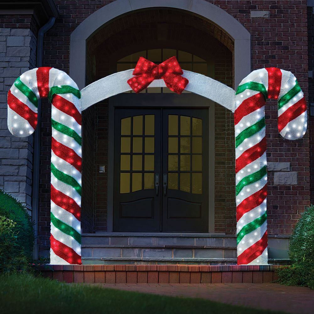 Outdoor Candy Cane Lights The illuminated candy cane archway hammacher schlemmer the illuminated candy cane archway workwithnaturefo