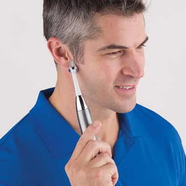 The Tinnitus Relief Wand - Model with wand against ear