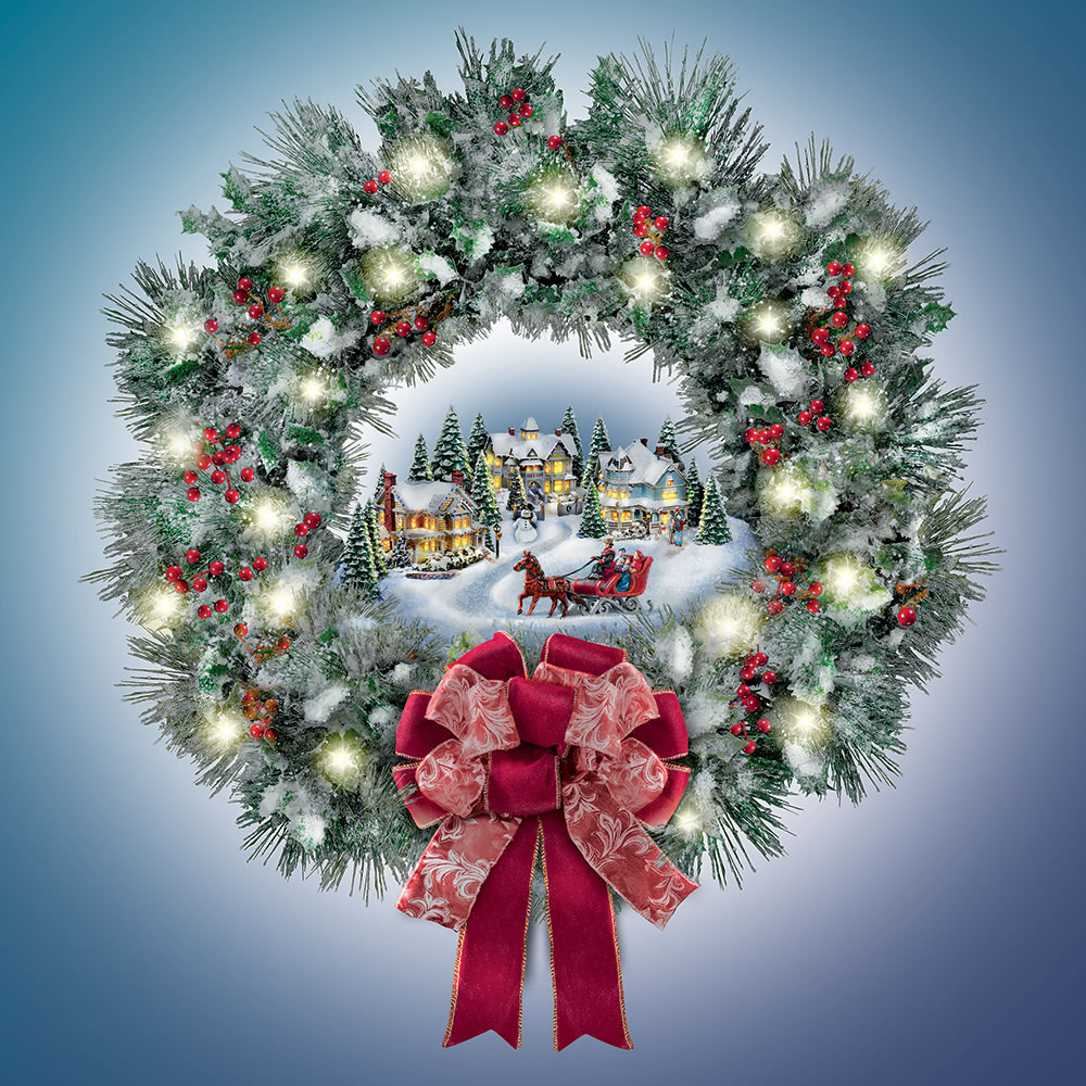 The Thomas Kinkade Illuminated Holiday Wreath Hammacher Schlemmer
