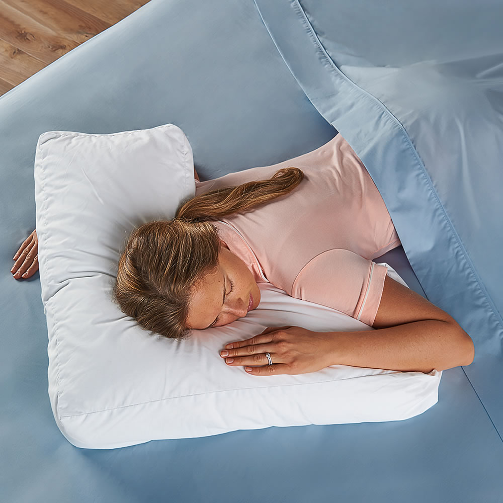 The Shoulder Supporting Comfort Pillow Hammacher Schlemmer