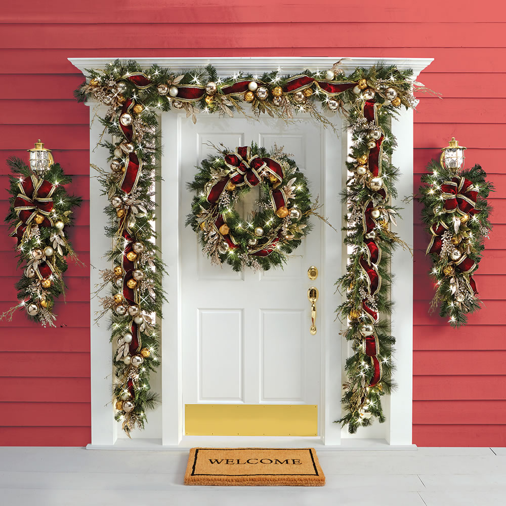 the cordless prelit crimson and gold holiday trim garland on door