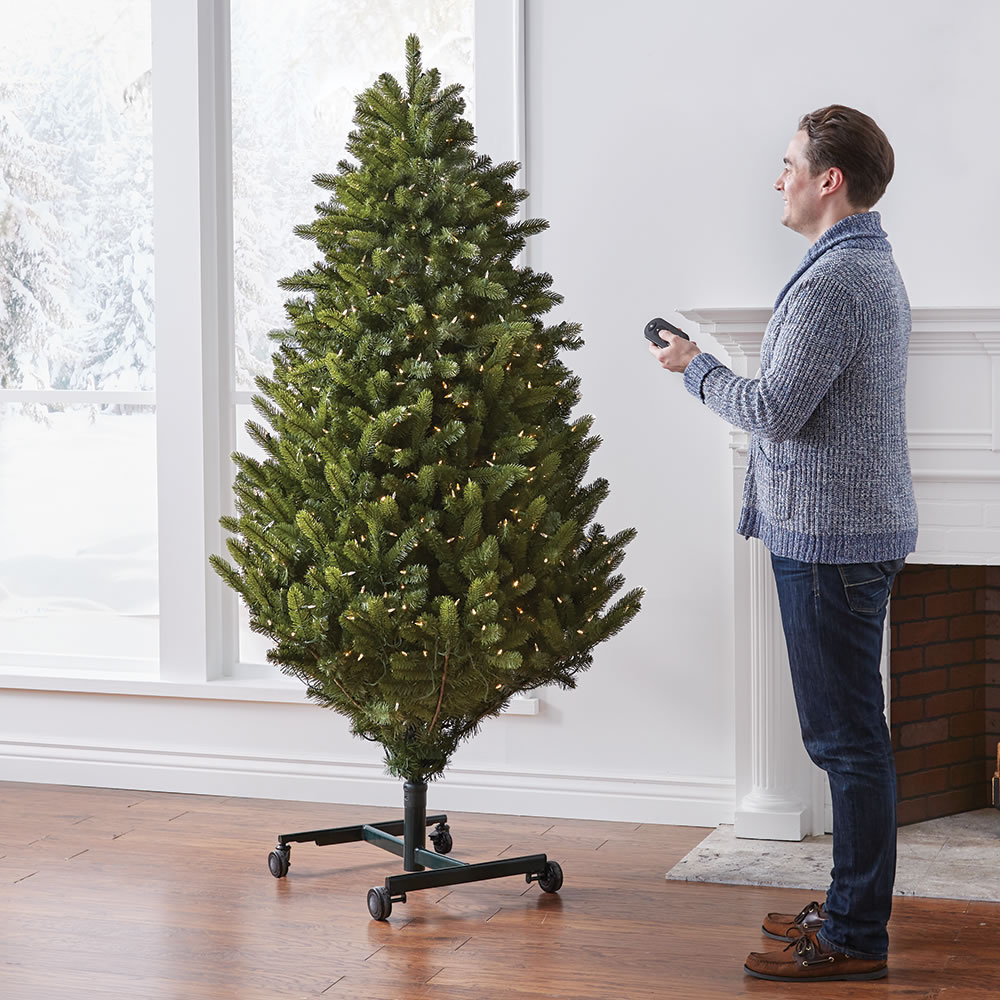 The Remote Controlled Height Adjustable Christmas Tree - Hammacher ...