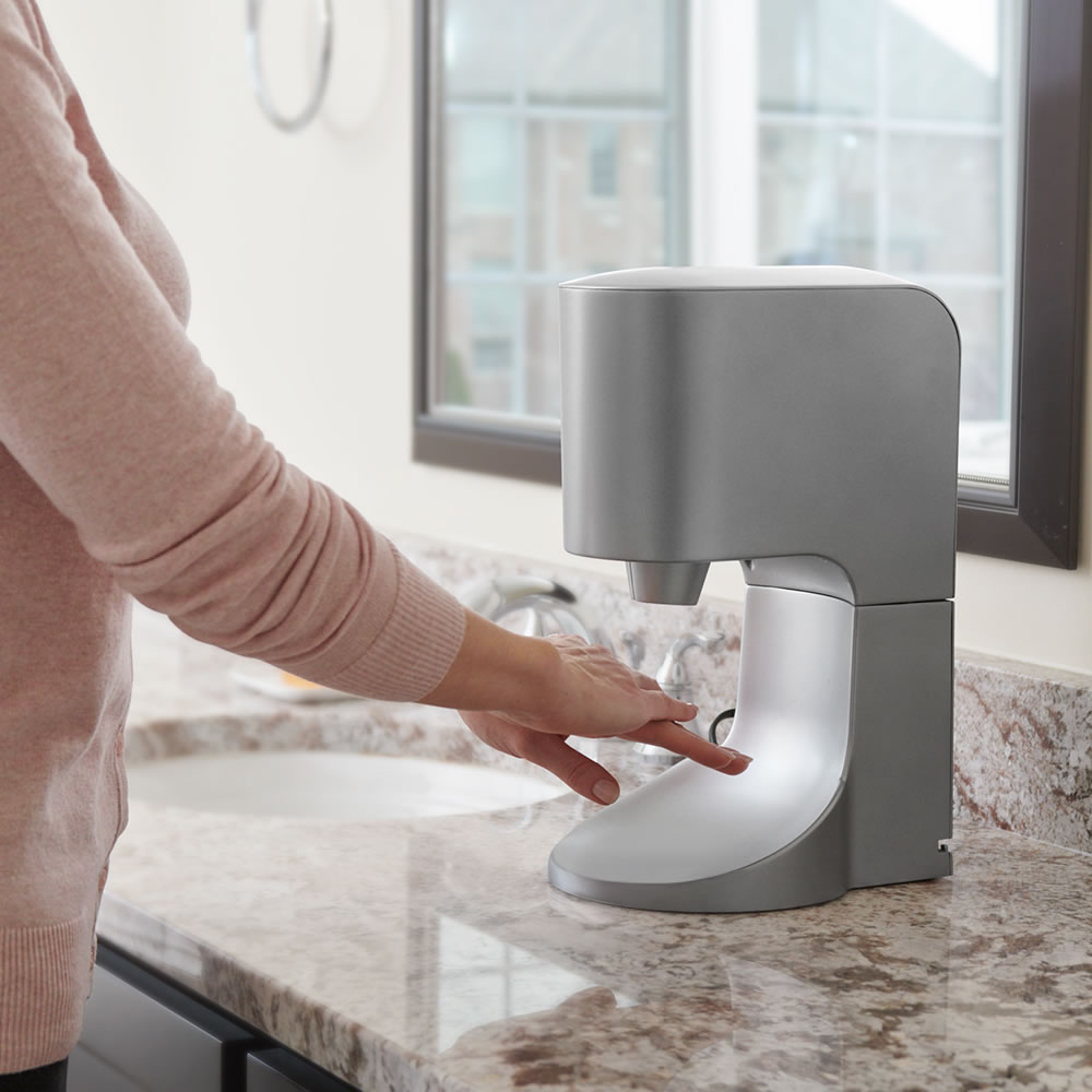 The Towel Eliminating Touchless Hand Dryer Hammacher Schlemmer