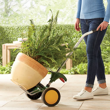 The Heavy Duty Potted Plant Hand Truck - Woman pushing hand truck
