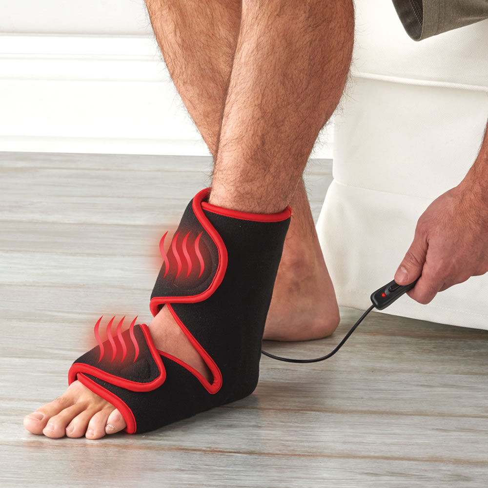 The LED Foot And Ankle Pain Reliever - Hammacher Schlemmer