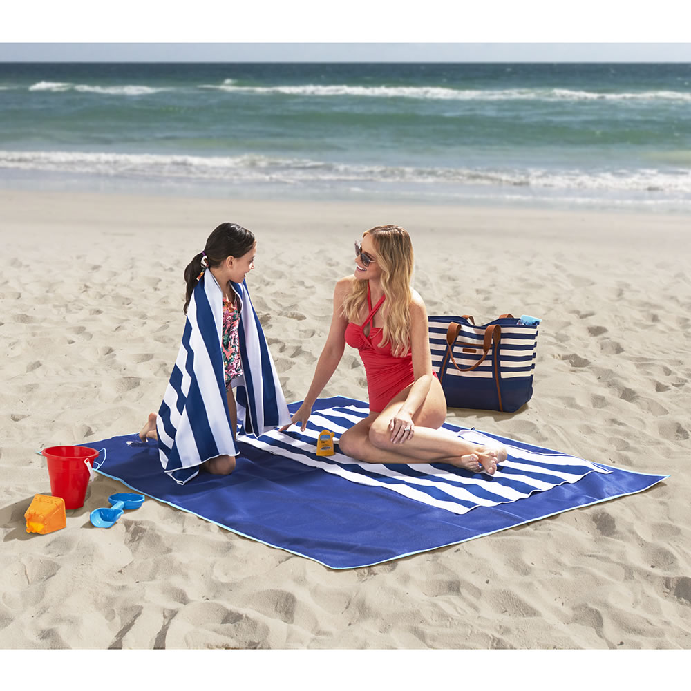 6dff8861d The Two Person Sandless Beach Mat - Hammacher Schlemmer