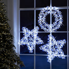 Hammacher Cordless Snowy Bough LED Light Show Christmas Wreath Multi Or White