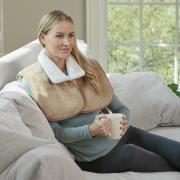 http://www.hammacher.com - The Sherpa Lined Neck And Shoulder Heat Wrap 99.95 USD